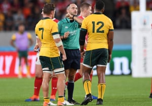 Romain Poite talks to Australia's Samu Kerevi after his tackle on Rhys Patchell of Wales