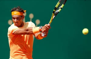 Nadal powers over a return.