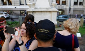 Tourists visit Alexander Hamilton's gravesite in the yard of Trinity church.