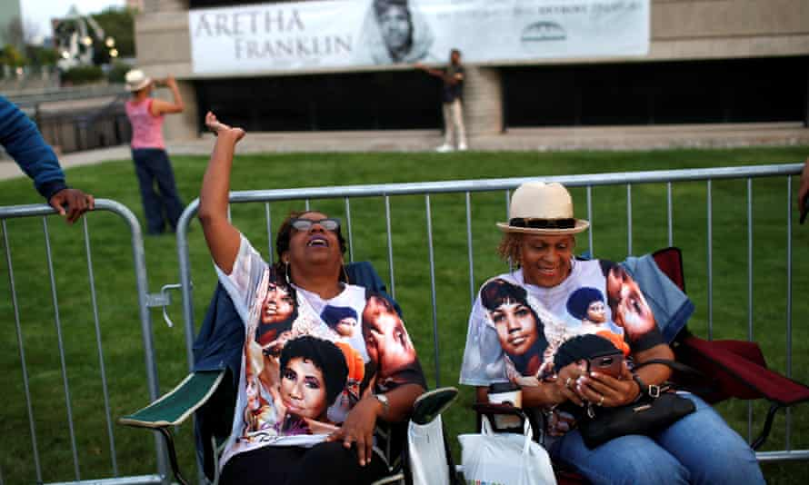People wait in line outside the museum where Aretha Franklin will lie for two days of public viewing in Detroit, Michigan.