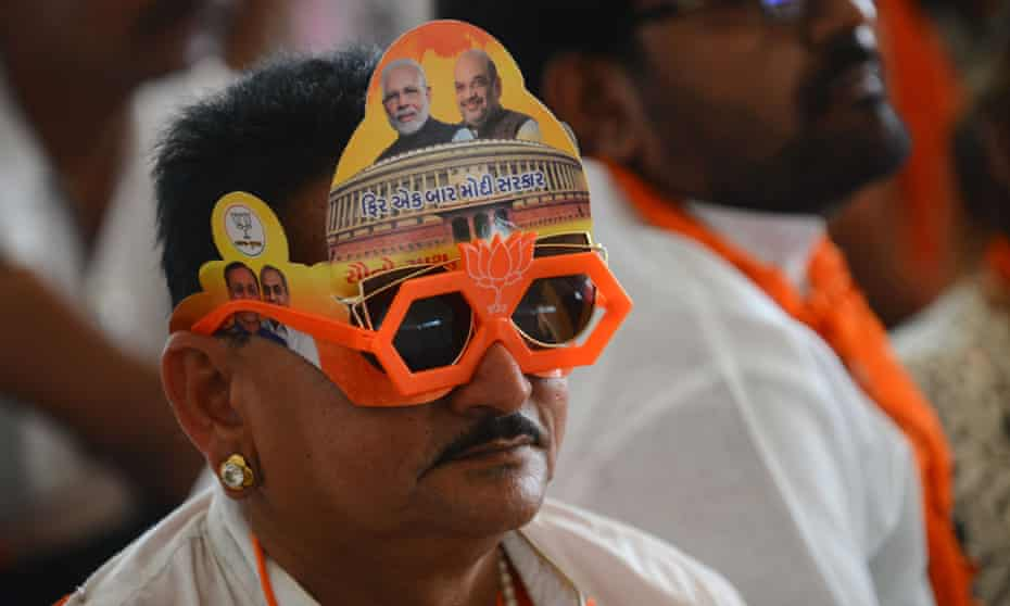 Flower power … a supporter of the Bhartiya Janta Party (BJP) wears its symbol, a lotus.