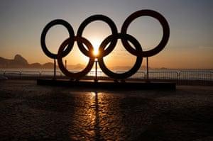 The sun rises over Copacabana beach
