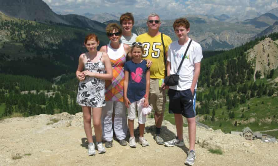 Before the fall: Stephen Purvis with his family before his arrest