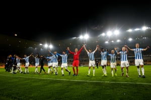 Synchronised celebrations: Huddersfield celebrate their 2-0 win over Wolves courtesy of two goals from Aaron Mooy