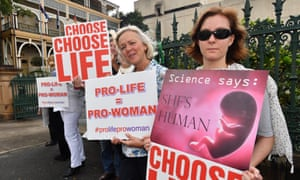 Anti-abortion protesters outside Parliament House in Brisbane on Tuesday.