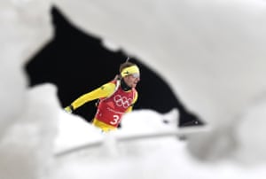 Peppe Femling of Sweden pictured through the snow during the Men's Biathlon.