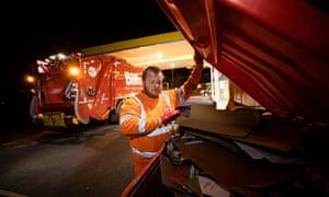 Biffa's Glynn Corker examines a bin in Rotherham