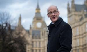 John Swinney in dark coat outside Palace of Westminster in London