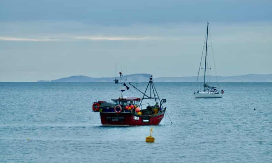 A trawler in Dorset bay on an overcast morning