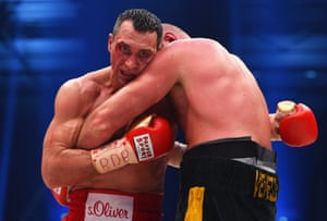 Wladimir Klitschko clings on to Tyson Fury during the heavyweight world title fight at Esprit-Arena in Düsseldorf, Germany
