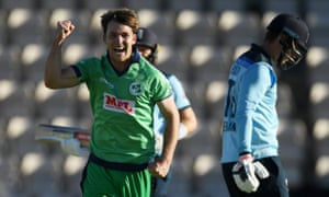 Curtis Campher of Ireland celebrates after taking the wicket of Tom Banton of England.