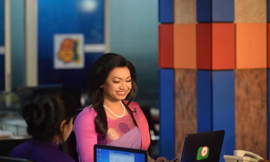 Tashnuva Anan Shishir presents the news at a news studio in Dhaka