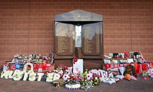 Flowers, shirts and photographs surround the eternal flame of the Hillsborough memorial tonight.