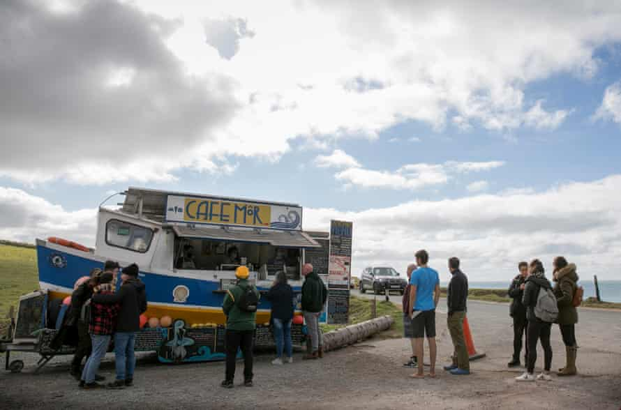 Customers await their orders at Jonathan William's seaweed truck Cafe Mor in Freshwater West, Pembrokeshire