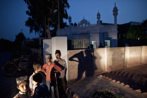 Members of the persecuted Ahmadiyya community gather after evening prayers outside a mosque on July 14, 2010 in Chenab Nagar, Pakistan. The Pakistani Ahmadis define themselves as Muslim, but could face years in prison if they openly declare or practice their faith.
