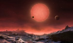 This artist's impression shows an imagined view from the surface one of the three planets. These worlds have sizes and temperatures similar to those of Venus and Earth and are the best targets found so far for the search for life outside the solar system.