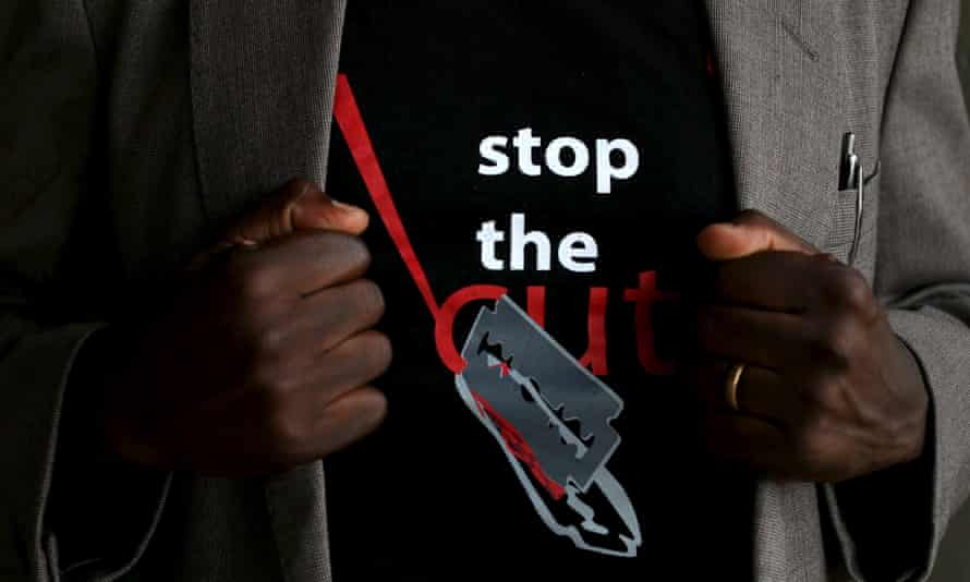 """Person wearing a T-shirt that reads: """"Stop the cut""""."""