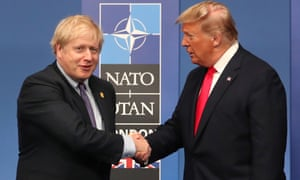 NATO Leaders Summit Takes Place In The UK - Day Two<br>HERTFORD, ENGLAND - DECEMBER 04: British Prime Minister Boris Johnson shakes hands with US President Donald Trump onstage during the annual NATO heads of government summit on December 4, 2019 in Watford, England. France and the UK signed the Treaty of Dunkirk in 1947 in the aftermath of WW2 cementing a mutual alliance in the event of an attack by Germany or the Soviet Union. The Benelux countries joined the Treaty and in April 1949 expanded further to include North America and Canada followed by Portugal, Italy, Norway, Denmark and Iceland. This new military alliance became the North Atlantic Treaty Organisation (NATO). The organisation grew with Greece and Turkey becoming members and a re-armed West Germany was permitted in 1955. This encouraged the creation of the Soviet-led Warsaw Pact delineating the two sides of the Cold War. This year marks the 70th anniversary of NATO. (Photo by  Steve Parsons-WPA Pool/Getty Images)