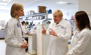 Boris Johnson with Dr Anna Godfrey (left) and Dr Sarah Bowdin during a visit to the National Institute for Health Research at Addenbrooke's hospital, Cambridge.