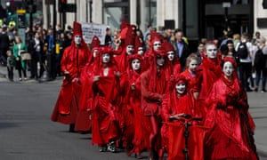 Members of the so called 'Red Brigade' march from Oxford Circus to Piccadilly Circus in London in protest against inaction over climate change