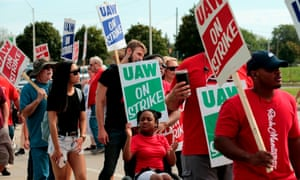 Striking workers and their families at a General Motors factory in Detroit, Michigan, amid low unemployment in the US.
