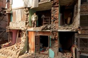 A homeowner oversees rebuilding of his house in Kathmandu, Nepal