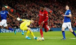 Liverpool's Divock Origi scores their first goal.