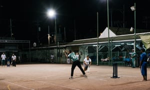'It's a Trini thing': cage cricket played on a tennis court at the Harvard Club.