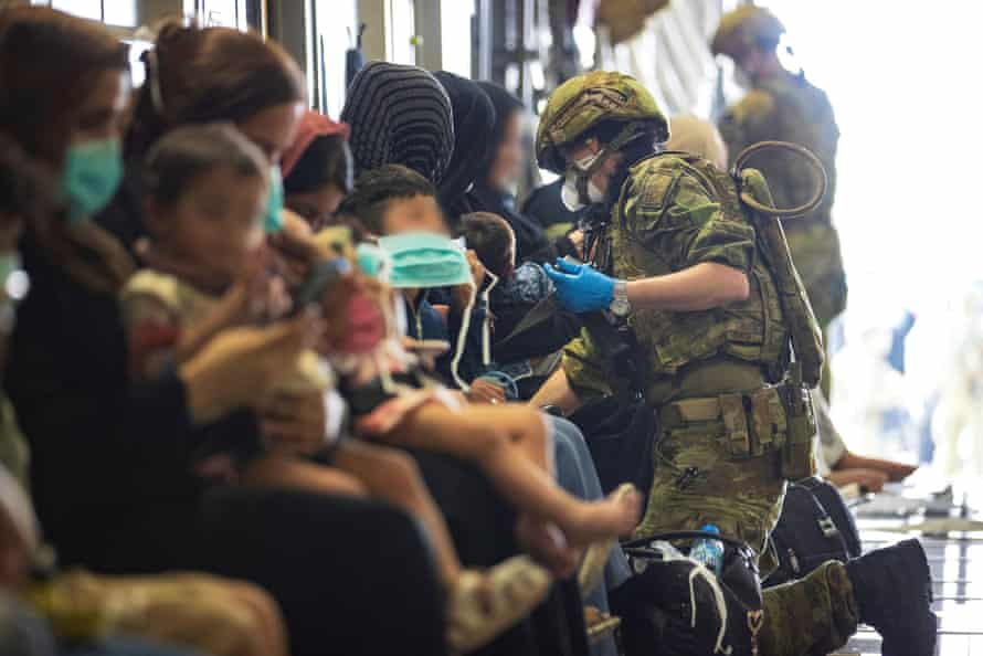 The Royal Australian Air Force Air assists Afghan evacuees before departure from Kabul airport on August 22.