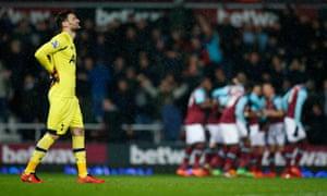 Tottenham's Hugo Lloris can't look as West Ham enjoy their match winning goal in the background