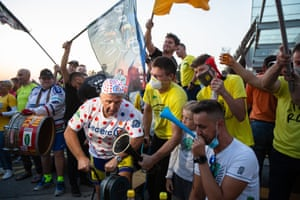 Fans in Tadej Pogacar's hometown of Komenda, Slovenia celebrate his win and cheer fellow countryman Primoz Roglic as they gather to wathc ht final stage and award ceremony on television.