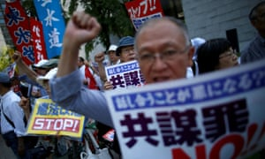 Protesters shout slogans as they protest against an anti-conspiracy bill outside parliament building in Tokyo.