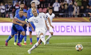 Finland's forward Teemo Pukki scores from the penalty spot.
