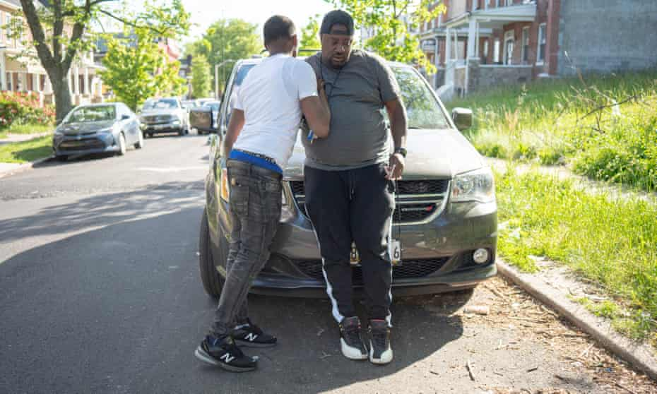 Jamal West embraces a Roca client before departing. The two finished a long conversation about helping the young man obtain a driver's license.