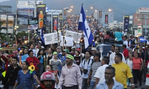 Protesters march on the Presidential House on Friday.