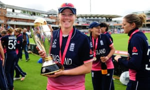 Anya Shrubsole poses with the World Cup trophy following England's defeat of India.