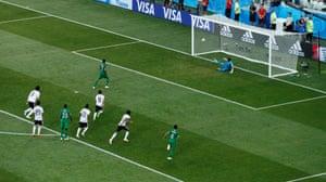 Essam El Hadary dives the wrong way as Salman Al-Faraj scores.