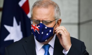 Scott Morrison removes his face mask at his press conference on Friday