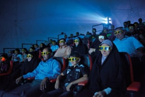 Iraqis watch a 3-D movie in Baghdad, February 2010