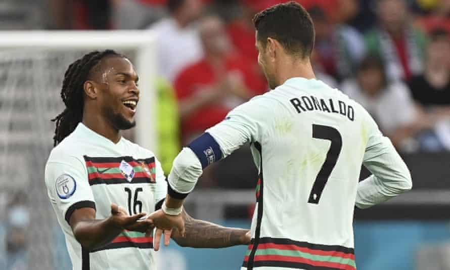 Renato Sanches celebrates with goalscorer Cristiano Ronaldo