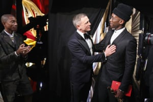 Daniel Craig and Mahershala Ali – who won best actor in a supporting role – pose backstage