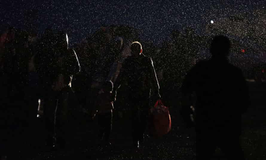 Refugees in heavy rain