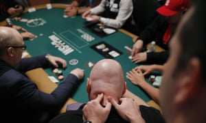 Stressful hand … a player gets a message during the first day of the World Series of Poker in Las Vegas last week.