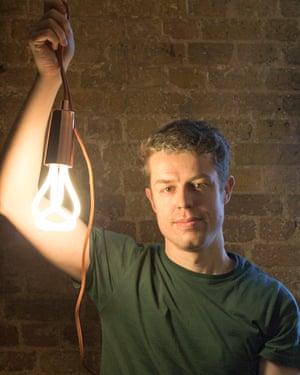 man holding lightbulb