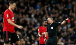Nemanja Matic (left) walks off after being shown a second yellow card during the Carabao Cup semi-final second leg at the Etihad.