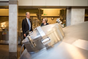 Chancellor Philip Hammond is shown around Fuller's Brewery by Head Brewer, Georgina Young.