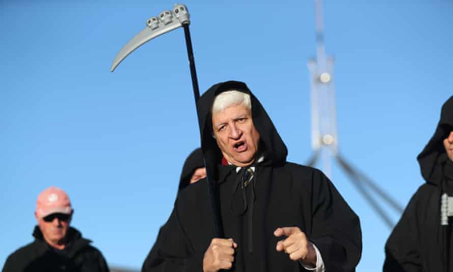 Bob Katter dressed as the Grim Reaper to protest the death of the Australian car industry on the forecourt of parliament house in Canberra