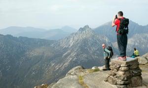 Climbers enjoying scenery from top of Goatfell, Isle of Arran, Scotland