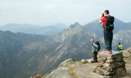 Climbers enjoying scenery from top of Goatfell, Isle of Arran, Scotland