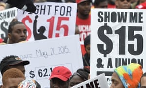 Protesters demand higher wages at an earlier rally.
